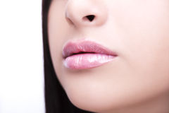Sexy Lips. Beauty Lipgloss Makeup Detail. Royalty Free Stock Photography