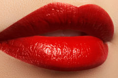 Sexy Lips. Beauty Red Lips. Beautiful make-up Closeup. Sensual Mouth. Lipstick and Lipgloss Stock Photo