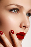 Sexy lips. Beauty red lips makeup detail. Beautiful make-up clos. Eup. Beautiful fashion model girl face. Perfect skin. Make up. Red manicure Royalty Free Stock Image