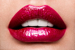 Sexy Lips. Beauty Red Lips Makeup Detail. Beautiful Make-up Closeup. Sensual Open Mouth. lipstick or Lipgloss Royalty Free Stock Photography
