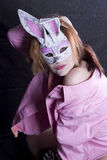 Sexy Little Easter Bunny in Pink. Beautiful little redhead dressed up as a bunny in a pink shirt Royalty Free Stock Photography
