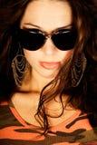 Sexy long brown hair fashion woman. Sexy long brown hair fashion model woman  in orange camo shirt wearing sunglasses Stock Photography