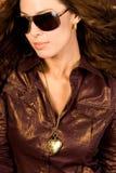 Sexy long brown hair fashion woman. Sexy long brown hair fashion model woman in tight brown leather dress Stock Photo
