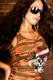 Sexy long brown hair fashion woman. Sexy long brown hair fashion model woman  in orange camo shirt wearing sunglasses Stock Images