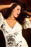 Sexy long brown hair fashion woman. Sexy long brown hair fashion model woman dancing in white top Royalty Free Stock Photos