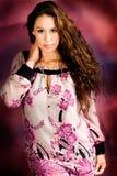 Sexy long brown hair fashion woman. Sexy long brown hair fashion model woman against pink background Stock Image