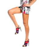 Sexy long female legs isolated white background Stock Photo