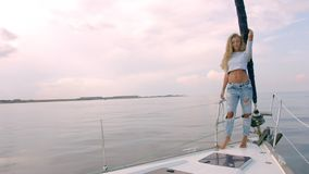 Sexy long hair girl on yacht stock video