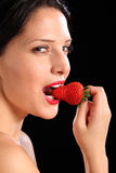 Sexy look by woman eating fresh strawberry fruit Stock Image