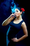 Sexy looking spanish women smoking cigarette Royalty Free Stock Photos