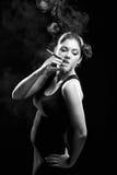 Sexy looking spanish women smoking cigarette Stock Image