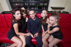 Sexy lovelace man surrounded by hot women wanting Royalty Free Stock Image
