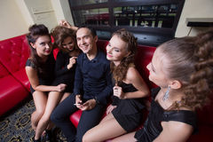 Sexy lovelace man surrounded by hot women wanting Stock Image