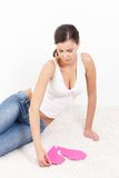 lovelorn woman with pink paper heart Stock Photo