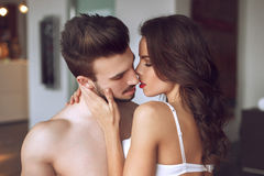 Sexy lovers foreplay at luxury flat Stock Images