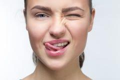 Sexy Mädchen mit der Zunge Stockfotos