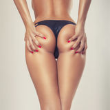 Sexy Mädchenkolben, ohne Cellulite Stockbild