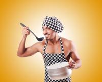 Sexy männlicher Koch gegen die Steigung Lizenzfreies Stockbild