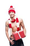 Sexy macho holding red gift Stock Photo