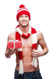 Sexy macho holding red gift Stock Photography