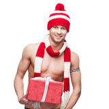 Sexy macho holding red gift Royalty Free Stock Image