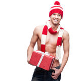 Sexy macho holding red gift Royalty Free Stock Photo