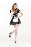 Sexy maid. Beautiful young maid in white pantyhose holding brush Royalty Free Stock Images