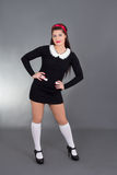 Sexy maid in black uniform Stock Photos