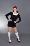 Sexy maid in black uniform Stock Photos