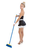Sexy maid with broom Stock Image