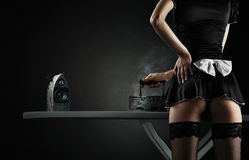 Sexy maid with iron audio speakers Stock Photos