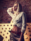 Sexy makeup blond woman posing in white shirt and skirt with mod Stock Images