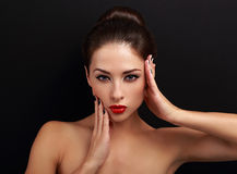 Sexy makeup female model posing with hand near face Royalty Free Stock Photography
