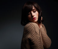 Sexy makeup female model posing in warm wool sweater Royalty Free Stock Photography