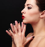 Sexy makeup profile woman face with black nails posing. Closeup Stock Images