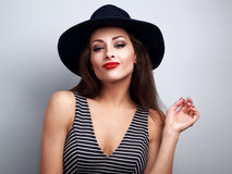 Sexy makeup woman in black fashion hat and bright red lipstick p Royalty Free Stock Image
