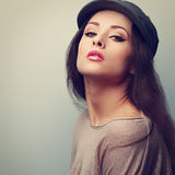 Makeup woman in cap posing with pink lipstick. Vintage closeup portrait stock photography