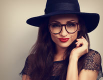 Sexy makeup woman in fashion eye glasses and hat with bright red Stock Image