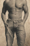 Male body. And image given an old vintage retro look with dust and scratches