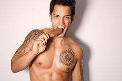 Sexy male eating ice cream Royalty Free Stock Photo