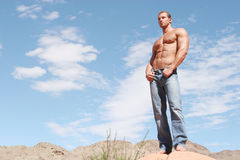 Sexy male model in blue jeans Stock Images