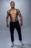 Sexy male model with braces. And jeans with sixpack posing topless Royalty Free Stock Image