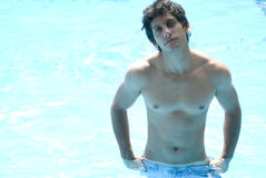 Sexy male model at the swimming pool Stock Photo