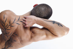 Sexy male's back with tattoo Stock Image