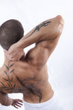 Sexy male's back with tattoo Royalty Free Stock Photos