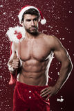 Sexy male santa Stock Photos