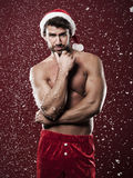 Sexy male santa Stock Images