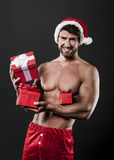 Sexy male santa with presents Stock Photography