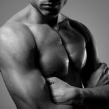 Man. Portrait of a handsome muscular young man. Shot in a studio.black and white.close up royalty free stock photos