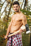 Sexy man with axe Royalty Free Stock Images
